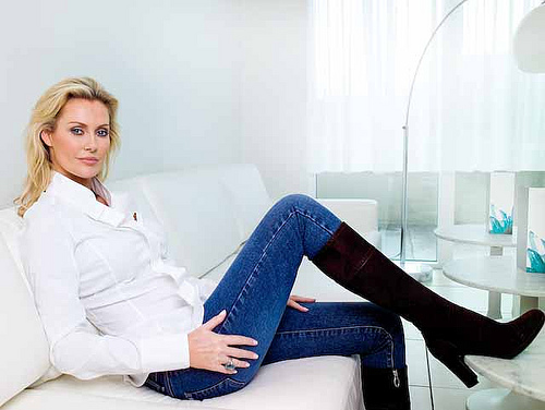 Alison Doody, sitting on on a sofa and aging gracefully